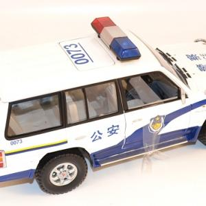 Autominiature01 com mitsubishi pajero 1998 police chine 1 18 sunstar 3