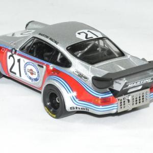 Porsch 911 rsr carrera 1974 mans schurti 1 43 ixo 158b autominiature01 2