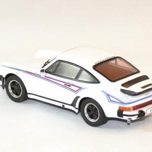Porsche 911 ixoist martini 1975 1 43 autominiature01 2